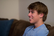 Alex Lee aka #AlexFromTarget relaxes on the couch to watch some television at his home on November 10, 2014 in Frisco, Texas. (Cooper Neill for The New York Times)
