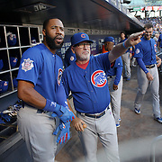 NEW YORK, NEW YORK - July 02: Manager Joe Maddon #70 of the Chicago Cubs with Jason Heyward #22 of the Chicago Cubs in the dugout during the Chicago Cubs Vs New York Mets regular season MLB game at Citi Field on July 02, 2016 in New York City. (Photo by Tim Clayton/Corbis via Getty Images)