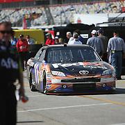 Sprint Cup Series driver Denny Hamlin (11) drives his car through the garage area at Daytona International Speedway on February 18, 2011 in Daytona Beach, Florida. (AP Photo/Alex Menendez)