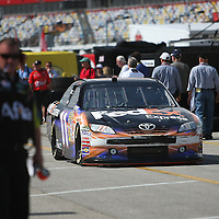 Sprint Cup Series driver Denny Hamlin (11) drives his car through the garage area at Daytona International Speedway on February 18, 2011 in Daytona Beach, Florida. (AP Photo/Alex Menendez)