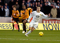Photo: Leigh Quinnell.<br /> Wolverhampton Wanderers v Leeds United. Coca Cola Championship. 17/12/2005. Leeds' Liam Miller sprints a way from Leeds' Rohan Ricketts.