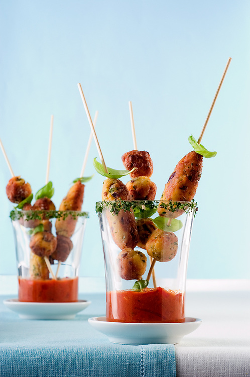 Meatballs on a skewer with tomato sauce