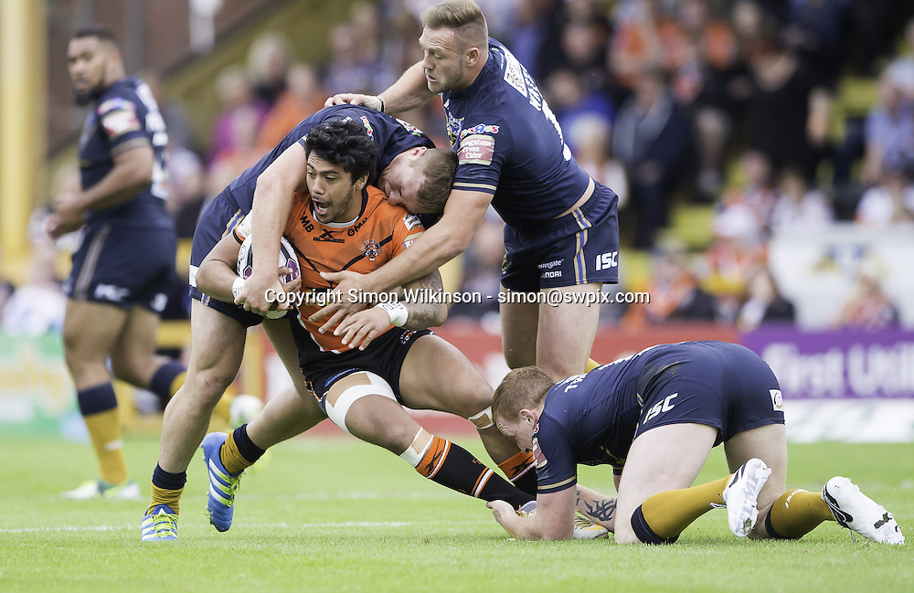 Picture by Allan McKenzie/SWpix.com - 19/06/2016 - Rugby League - First Utility Super League - Castleford Tigers v Hull FC - the Mend A Hose Jungle, Castleford, England - Castleford's Denny Solomona is tackled by Hull FC's Scott Taylor, Liam Watts & Jordan Thompson.