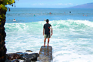 Surfer Kyle checking the surf before he enters at pools.