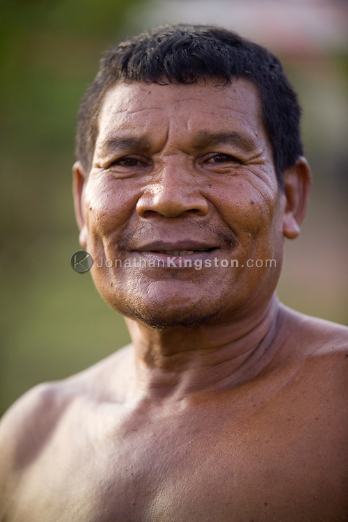 A portrait of a man working in the remote, indigenous Miskito village, Krin Krin, Nicaragua, on the Rio Coco.  Miskito are First Nation people, or Native Americans, along the eastern parts of Nicaragua and Honduras. All residents speak their native language, Miskito, and few speak any Spanish. The area continues to struggle after numerous years of crop failure, aftermath of the Contra War, and natural disasters like Hurricane Mitch.