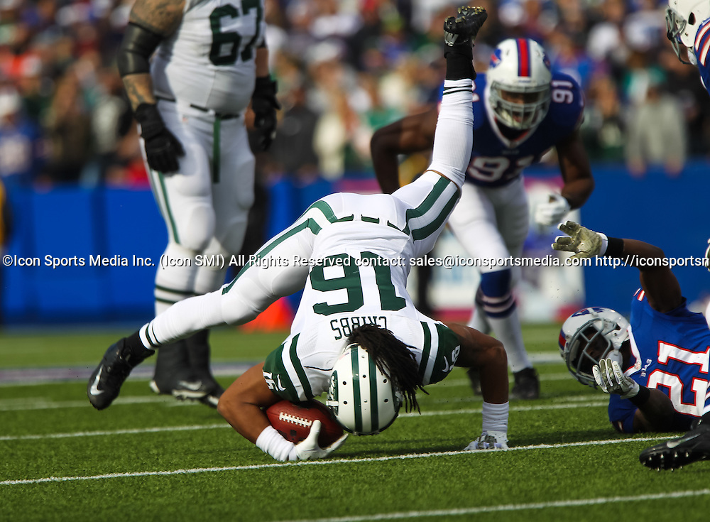 17 November 2013: New York Jets wide receiver Josh Cribbs (16) is sent flying after being tackled by Buffalo Bills cornerback Leodis McKelvin (21) during a NFL game between the New York Jets and the Buffalo Bills at Ralph Wilson Stadium in Orchard Park, NY.