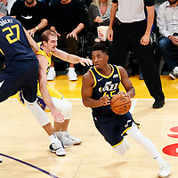 10 October 2017: Utah Jazz guard Donovan Mitchell (45) drives past Los Angeles Lakers guard Alex Caruso (4) on a screen set by Utah Jazz center Rudy Gobert (27) during the Utah Jazz 105-99 victory over the LA Lakers, at the Staples Center, Los Angeles, California, USA.