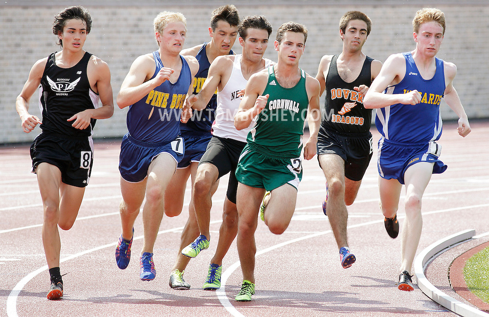 Washingtonville's Connor Quinn, at right, and the rest of the field take off at the start of the 800-meter run at the Section 9 track and field state qualifying meet in Middletown on Friday, May 30, 2013. Quinn won the race.