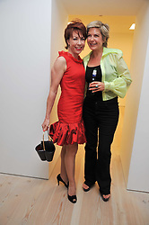 Left to right, KATHY LETTE and PENNY SMITH at an exhibition of photographic portraits by Bryan Adams entitled 'Hear The World' at The Saatchi Gallery, King's Road, London on 21st July 2009.