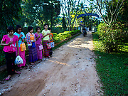 19 NOVEMBER 2017 - HWAMBI, YANGON REGION, MYANMAR: Girls pray before mass on the driveway of Sacred Heart's Catholic Church in Hwambi, about 90 minutes north of Yangon. Catholics in Myanmar are preparing for the visit of Pope Francis. He is coming to the Buddhist majority country November 27-30. There about 500,000 Catholics in Myanmar, about 1% of the population. Catholicism was originally brought to what is now Myanmar more than 500 years ago by Portuguese missionaries and traders.    PHOTO BY JACK KURTZ