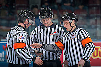 KELOWNA, CANADA - FEBRUARY 1: Referees Bryan Bourdon and Mark Pearce stand at centre ice with linesman Dustin Minty at the Kelowna Rockets against the Calgary Hitmen on February 1, 2017 at Prospera Place in Kelowna, British Columbia, Canada.  (Photo by Marissa Baecker/Shoot the Breeze)  *** Local Caption ***