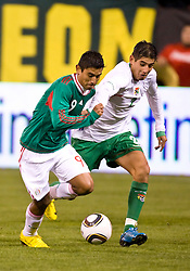 February 24, 2010; San Francisco, CA, USA;  Mexico forward Alberto Medina (9) dribbles past Bolivia defender Ronald Eguino (2) during the second half at Candlestick Park. Mexico defeated Bolivia 5-0.