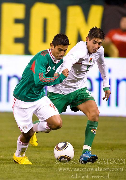 February 24, 2010; San Francisco, CA, USA;  Mexico forward Alberto Medina (9) dribbles past Bolivia defender Ronald Eguino (2) during the second half at Candlestick Park. Mexico defeated Bolivia 5-0.