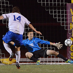 Photos by Tom Kelly IV<br /> Conestoga goalkeeper Will Smith (00) can't come up with the save on this game winning penalty kick in overtime by Great Valley's Ryan	Wilk (14) during the Great Valley vs Conestoga boys District One semifinal soccer game which was held Wednesday night October 30, 2013 at West Chester East High School.