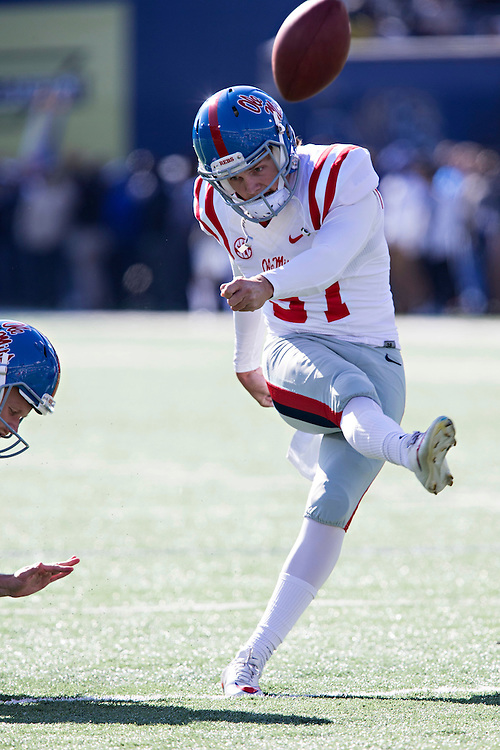 MEMPHIS, TN - OCTOBER 17:  Gary Wunderlich #97 of the Ole Miss Rebels kicks during warm ups before a game against the Memphis Tigers at Liberty Bowl Memorial Stadium on October 17, 2015 in Memphis, Tennessee.  The Tigers defeated the Rebels 37-24.  (Photo by Wesley Hitt/Getty Images) *** Local Caption *** Gary Wunderlich