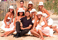 "ATLANTIC CITY, NJ - JUNE 26: Unidentified Maxim Girls pose with a man for a photograph at the Maxim Magazine Presents ""Fantasy Island"" at the Borgata Hotel Casino and Spa June 26, 2004 in Atlantic City, New Jersey. The event consisted of two music stages and four unique themed areas, providing a wide array of entertainment for guests; South Beach Venice Beach, Stuffland, and The Oasis. (Photo by William Thomas Cain/Getty Images)"