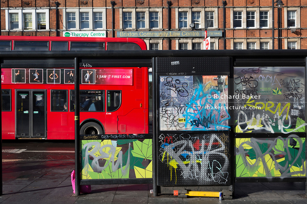 A graffiti-covered bus stop in Brixton, on 30th january 2019, in Lambeth, south London, England.