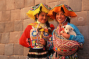 PERU, HIGHLANDS, CUZCO young Indian girls in traditional dress