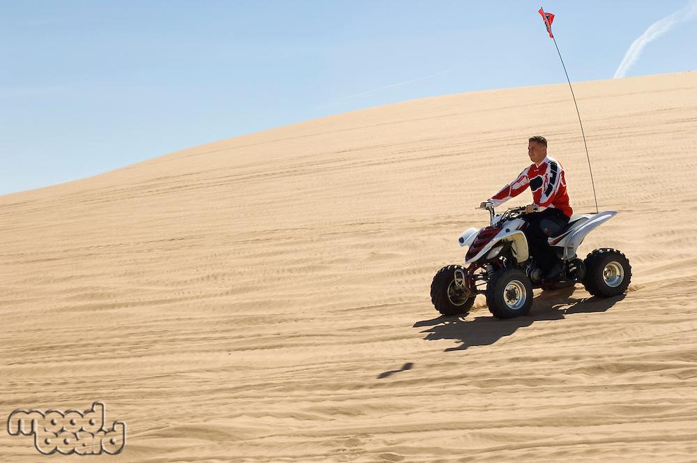 Young Man on ATV on Sand Dune