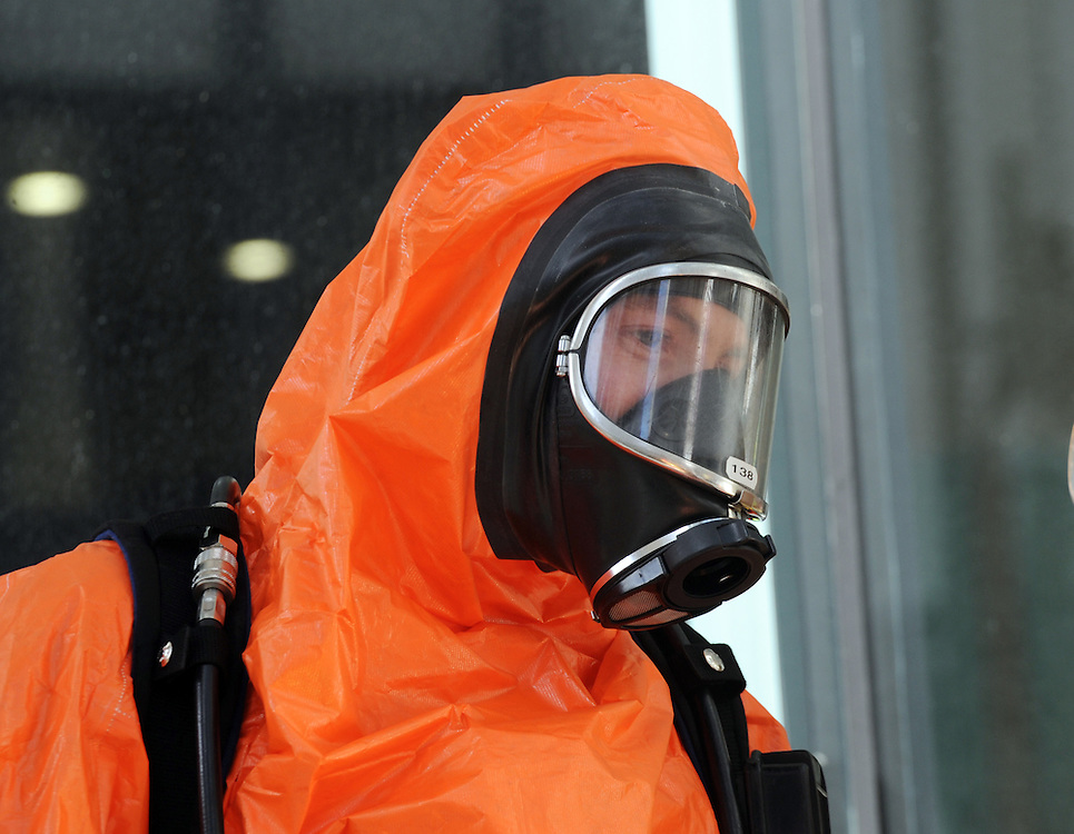 Fire crew suit up in protective clothing attending a report of white powder in the Treasury Building on the Terrace, Wellington, New Zealand, Monday, July 15, 2013. Credit:SNPA / Ross Setford