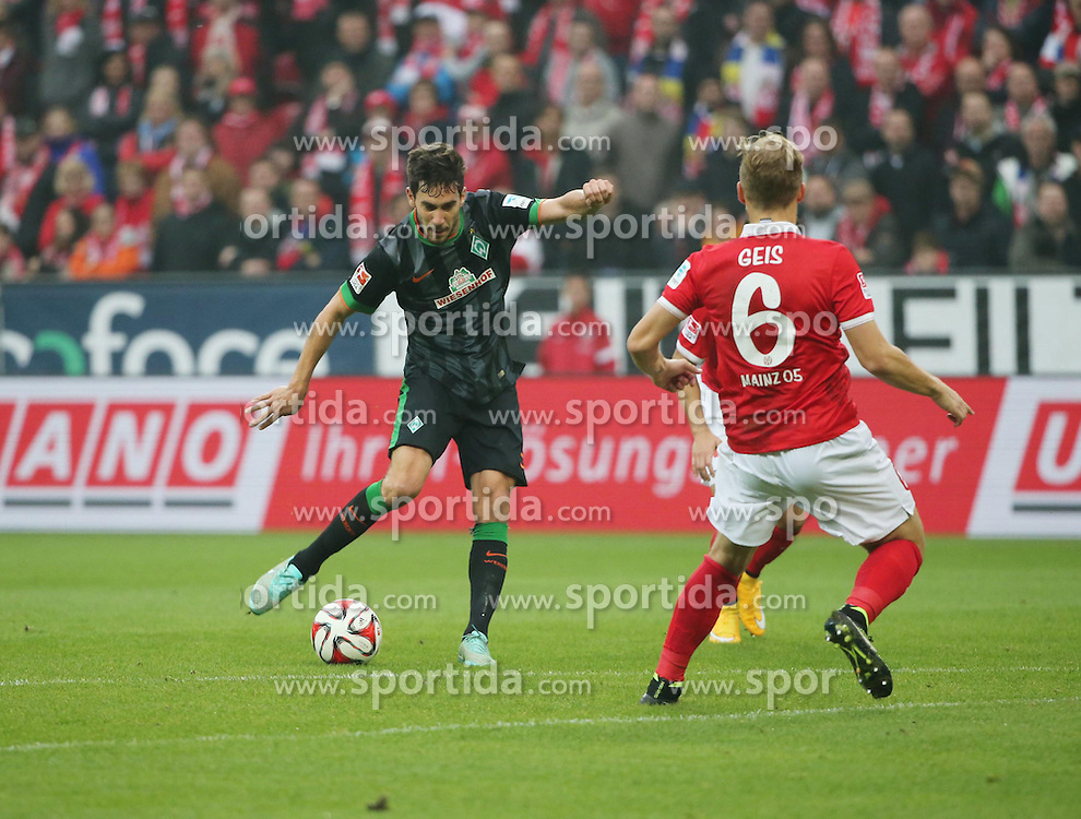 01.11.2014, Coface Arena, Mainz, GER, 1. FBL, 1. FSV Mainz 05 vs SV Werder Bremen, 10. Runde, im Bild v.l.: Santiago Garcia (Bremen) gegen Johannes Geis (Mainz) // during the German Bundesliga 10th round match between 1. FSV Mainz 05 and SV Werder Bremen at the Coface Arena in Mainz, Germany on 2014/11/01. EXPA Pictures &copy; 2014, PhotoCredit: EXPA/ Eibner-Pressefoto/ Neurohr<br /> <br /> *****ATTENTION - OUT of GER*****