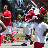 Members of Navassa Drum and Drill perform during the North Carolina 4th of July Festival Parade Friday July 4, 2014 in Southport, N.C.