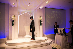June 30, 2017 - Tokyo, Shinagawa, Japan - TOKYO, JAPAN - JUNE 30: Anime fan marry his VR (Virtual Reality) anime girl crush in front of an altar of a chapel in Tokyo, Japan on June 30, 2017. A marketing event by Japanese video game maker Hibiki Works, from the latest romance video game Niitzuma LovelyxCation, will let you experience getting married with anime virtual brides and exchange wedding vows in real life. (Photo: Richard Atrero de Guzman/NUR Photo) (Credit Image: © Richard Atrero De Guzman/NurPhoto via ZUMA Press)