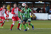 Lyle Taylor forward for AFC Wimbledon (33) is put under pressure during the Sky Bet League 2 play-off 2nd leg match between Accrington Stanley and AFC Wimbledon at the Fraser Eagle Stadium, Accrington, England on 18 May 2016. Photo by Stuart Butcher.