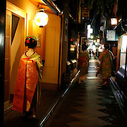 Pontocho is a narrow alley running from Shijo-dori to Sanjo-dori, one block west of the Kamo River. On occasion Geishas can be seen strolling the alley crammed with bars and tea houses frequented by locals and tourists.<br />  Photograph by Jose More