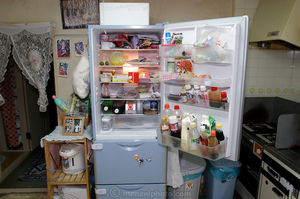 Middle class kitchen and open refrigerator, Kobe, Japan. (Supporting image from the project Hungry Planet: What the World Eats)