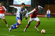 Walsall FC forward Tom Bradshaw and Fleetwood Town Defender Amari'i Bell during the Sky Bet League 1 match between Fleetwood Town and Walsall at the Highbury Stadium, Fleetwood, England on 15 March 2016. Photo by Pete Burns.