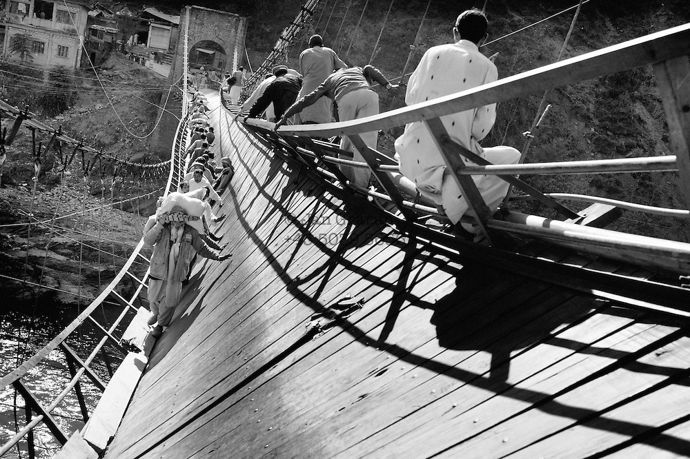 The bridge over the Neelum river at the village of Patikka, 14 kilometres from the epicentre. For many people, this was their only route to help. After several days of trekking across the mountains with injured family members on their backs, the exhausted survivors did not always manage to cross this final barrier; some fell into the river and drowned.  Nov. 2005