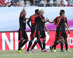 27.07.2014, Imtech Arena, Hamburg, GER, Telekom Cup, Hamburger SV vs Borussia Dortmund, im Bild Rafael van der Vaart (Mittelfeld / HSV / n23) trifft zur 2:1 F¬ührung / Fuehrung. Jacques Zoua (Angriff / HSV / n31), Artjoms Rudnevs (Angriff / HSV / n16), Zoltan Stieber (Mittelfeld / HSV / n17), // during the Telekom Cup Match between Hamburger SV and Borussia Dortmund at the Imtech Arena in Hamburg, Germany on 2014/07/27. EXPA Pictures © 2014, PhotoCredit: EXPA/ Eibner-Pressefoto/ dap<br /> <br /> *****ATTENTION - OUT of GER*****