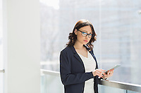 Portrait of confident businesswoman using tablet PC in office