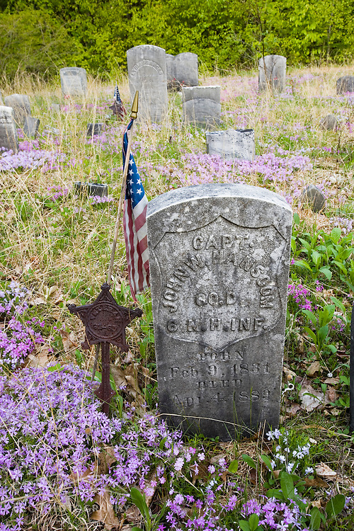 An old town cemetery near the Moose Mountains Reservation in Middleton, New Hampshire. Civil War Veteran. Society for the Protection of New Hampshire Forests preserve.  Spring.