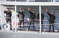 Officers wave to friends and family as the type 23 frigate HMS Richmond returns to Portsmouth Royal Navy Base following a seven-month deployment to the South Atlantic. Picture date: Friday 21st February, 2014. Photo credit should read: Christopher Ison. Contact chrisison@mac.com 07544044177