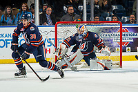 KELOWNA, CANADA - DECEMBER 29:  Jackson Caller #38 tries to block a shot as Dylan Ferguson #31 of the Kamloops Blazers defends the net against the Kelowna Rockets on December 29, 2018 at Prospera Place in Kelowna, British Columbia, Canada.  (Photo by Marissa Baecker/Shoot the Breeze)