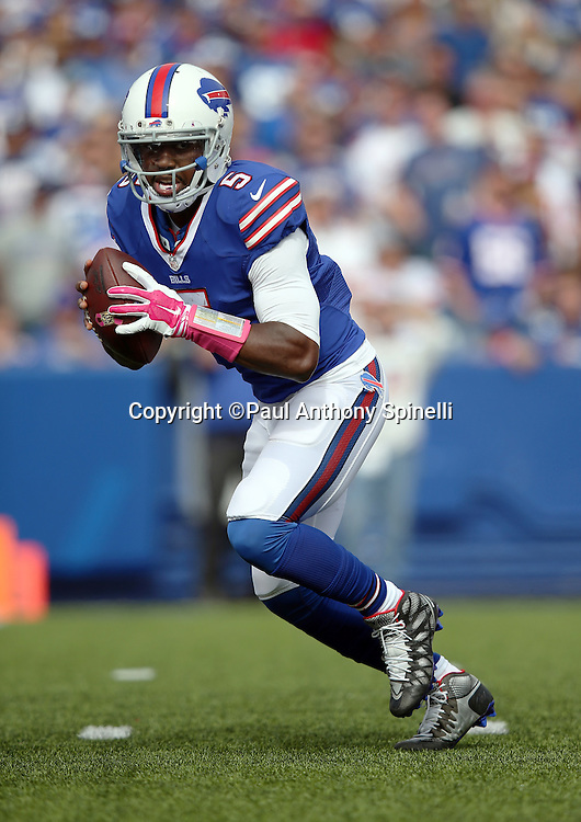 Buffalo Bills quarterback Tyrod Taylor (5) drops back to pass during the 2015 NFL week 4 regular season football game against the New York Giants on Sunday, Oct. 4, 2015 in Orchard Park, N.Y. The Giants won the game 24-10. (©Paul Anthony Spinelli)