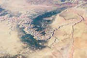 Out of this world: Photos of Grand Canyon taken by astronauts show natural wonder is just as awe-inspiring when seen from space<br /> <br /> Standing at the edge of the Grand Canyon is always a breath-taking experience but a new photo taken from the International Space Station shows that it is just as awe-inspiring from space.<br /> The latest image, which show the full expanse of the Grand Canyon as it cuts through the Kaibab Plateau, was taken by the Expedition 39 crew on March 25, as they orbited Earth. <br /> The photo shows the Colorado river, marked as a dark line snaking its way through the canyon's floor, as well as the forested areas along the north and south sides, which make up one of several vital eco-systems in the park.<br /> <br /> Jagged ridges rising above the surrounding arid landscapes also clearly mark out the 277-mile canyon, which was formed about 6 million years ago due to a combination of tectonic uplift and the Colorado river changing its course. <br /> Just as the Grand Canyon, with its 1.6km drop through sandstone and limestone, is a popular tourist attraction, bringing in up to 5 million visitors a year, it is also a popular landmark with Nasa's astronauts, who enjoying photographing it from the space station.<br /> <br /> Photo shows: Awe-inspiring: The jagged path of the Grand Canyon can be seen in this image taken by a crew on board the International Space Station<br /> ©Earth Observatory/Exclusivepix
