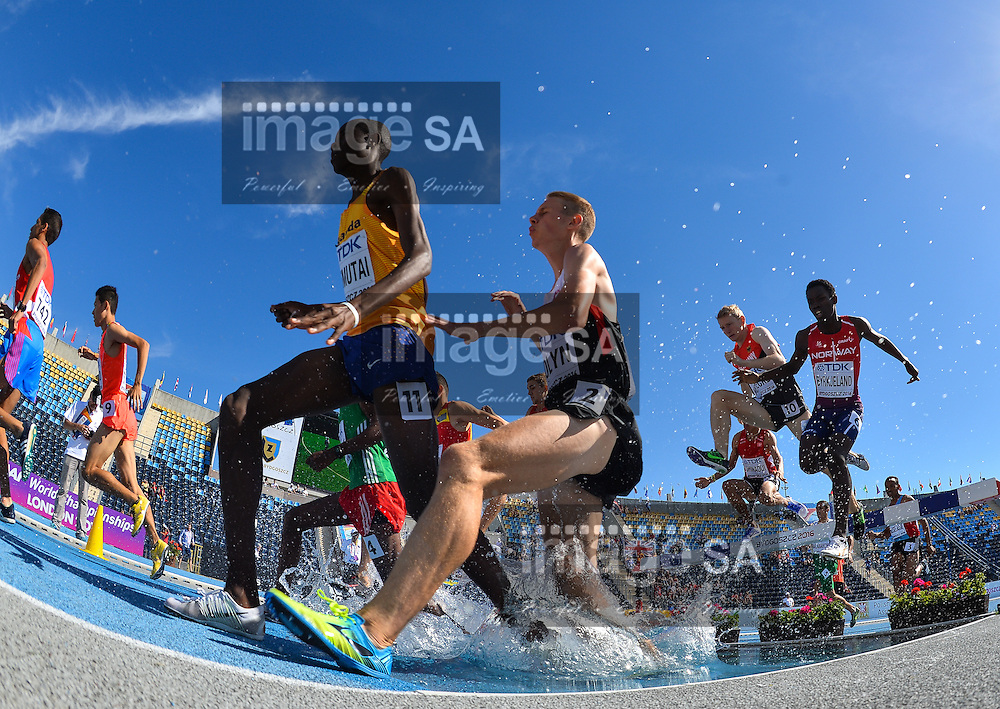 BYDGOSZCZ, POLAND - JULY 21: Albert Chemutai of Uganda and Nickolas Colyn of Canada at the water jump in the mens 3000m steeplechase during day 3 of the IAAF World Junior Championships at Zawisza Stadium on July 21, 2016 in Bydgoszcz, Poland. (Photo by Roger Sedres/Gallo Images)