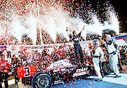 Team Penske driver Helio Castroneves celebrates in victory lane after winning the Kentucky Indy 300 at Kentucky Speedway in Sparta, Kentucky..Sports photography by Michael Hickey
