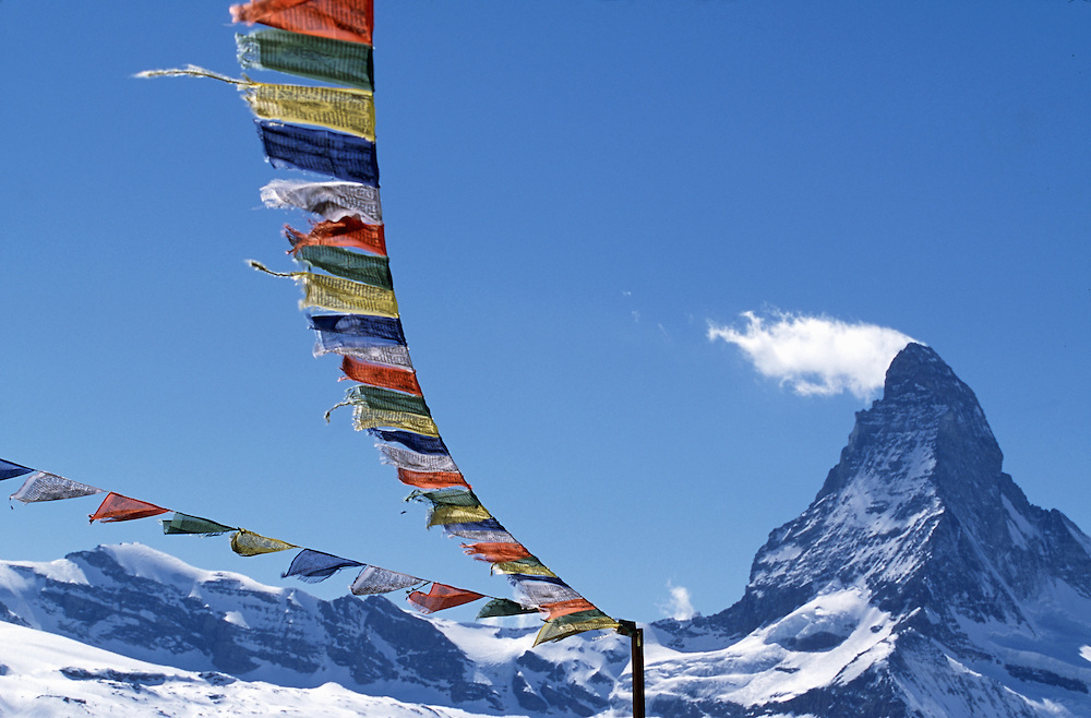 Travel. Prayer flags in the wind with a view of the Matterhorn, Zermatt, Switzerland