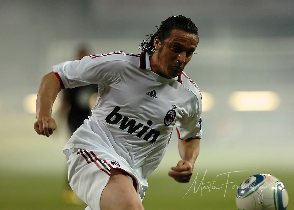 AC MIlan's Massimo Oddo chases the ball through a during the second half of his team's match at RFK Staium in Washington DC. Oddo scored both of his team's 3-2 loss to DC United.