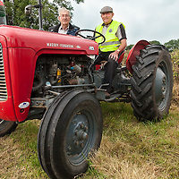 Brendan Price from Coolmeen and Sean Collins, from Sixmilebridge exhibiting the vintage tractors at the 2014 Kildysart Agricultural Show