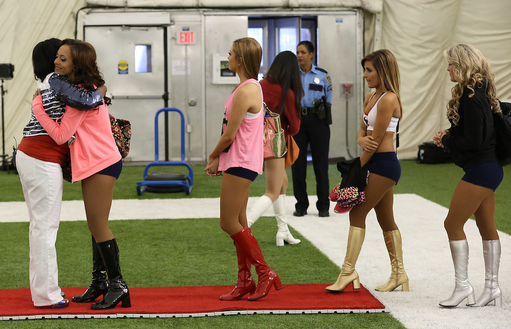 4/16/2014: Houston Texans Cheerleader Director Alto Gray hugs the fifteen girls that didn't make the team. Fifty girls showed up on April 16, 2014 at the Houston Texans practice facility in Houston, Texas to see which 35 girls made the 2014-2015, Houston Texans Cheerleading Team.