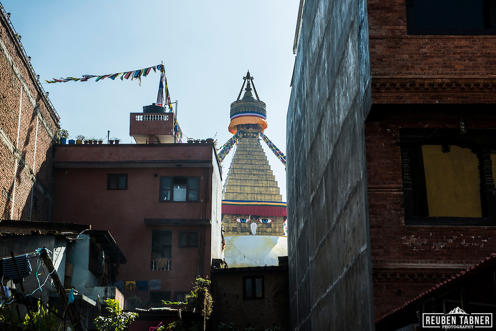 The Eyes of Buddha on the Boudhanath stupa rise above the near by housing in Kathmandu, Nepal.