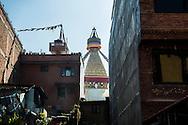 The Eyes of Buddha on the Boudhanath stupa rise above the near by housing in Kathmandu, Nepal.