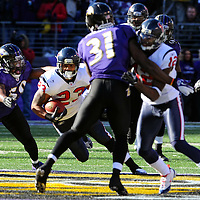 15 January 2012: Houston Texans running back Arian Foster (23) runs for a first down against Baltimore Ravens inside linebacker Dannell Ellerbe (59) in the Divisional Playoff at M&T Bank Stadium in Baltimore, MD. The Ravens defeated the Texans 20-13 to advance to the AFC Championship game..