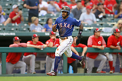 March 26, 2018 - Arlington, TX, U.S. - ARLINGTON, TX - MARCH 26: Texas Rangers center fielder Delino DeShields (3) rounds third base headed home for a run during the exhibition game between the Cincinnati Reds and Texas Rangers on March 26, 2018 at Globe Life Park in Arlington, TX. (Photo by Andrew Dieb/Icon Sportswire) (Credit Image: © Andrew Dieb/Icon SMI via ZUMA Press)