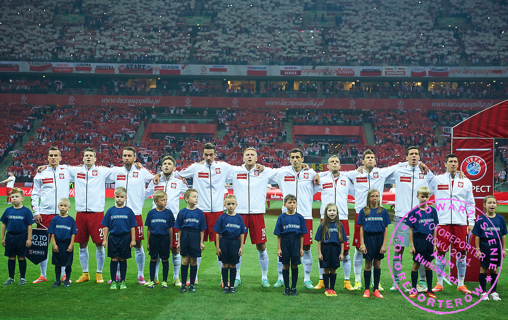 (L-R) Poland's Arkadiusz Milik and Lukasz Piszczek and Jakub Wawrzyniak and Maciej Rybus and Lukasz Szukala and Kamil Glik and Tomasz Jodlowiec and Kamil Grosicki and Grzegorz Krychowiak and goalkeeper Wojciech Szczesny and Robert Lewandowski stand while national anthem the EURO 2016 qualifying match between Poland and Germany on October 11, 2014 at the National stadium in Warsaw, Poland<br /> <br /> Picture also available in RAW (NEF) or TIFF format on special request.<br /> <br /> For editorial use only. Any commercial or promotional use requires permission.<br /> <br /> Mandatory credit:<br /> Photo by &copy; Adam Nurkiewicz / Mediasport